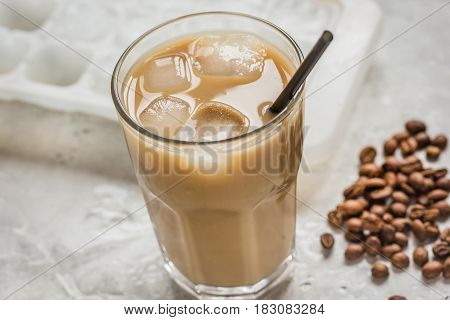 cold coffee glass with ice cubes for cafe menu on stone table background