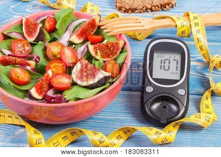 Fruit And Vegetable Salad And Glucometer With Tape Measure, Concept Of Diabetes, Slimming And Health