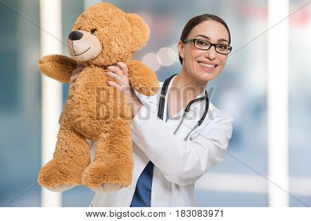Doctor holding a teddy bear