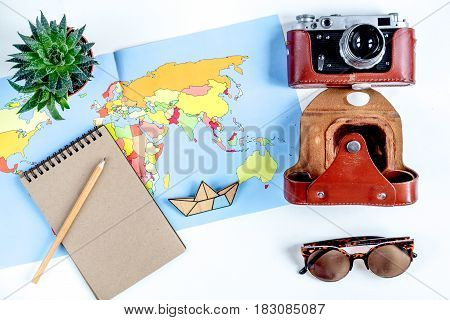 tourist lifestyle with camera and map on white table background top view