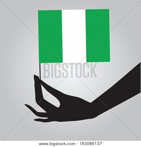 Flag of Nigeria in a female hand. Vector illustration.