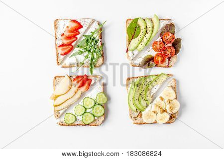 triangle sandwiches set on white table background top view