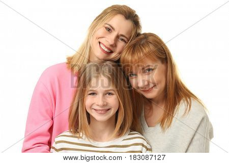 Happy young woman with her mother and daughter on white background