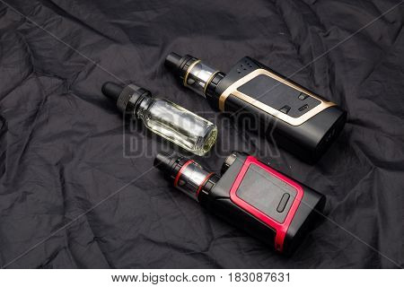 Vaping electronic mech mod and vape liquid.