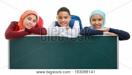 Schoolchildren with green school blackboard on white background