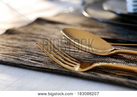 Cutlery on table set in restaurant, closeup