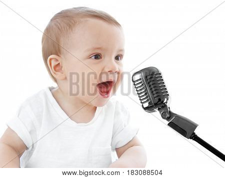 Cute baby with microphone on white background