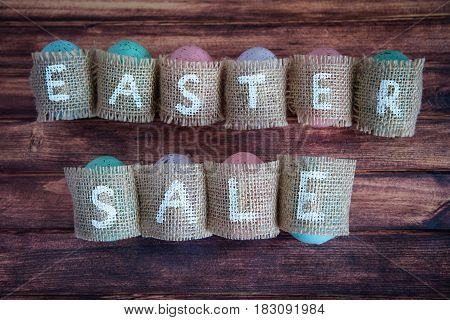 Easter concept: inscription Easter sale consisting on sacking. On wooden background waith copy space