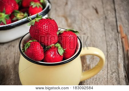 Heap Of Fresh Ripe Strawberries In A Jar On A Wooden Background. Rustic Style. Close Up.