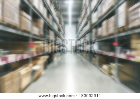 Blur Background Large Indoor Warehouse With High Racks And Products