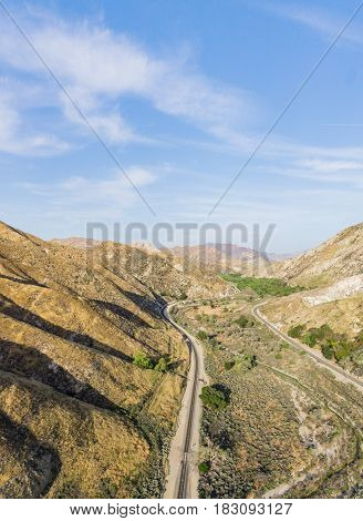 Long Railroad Track In Desert