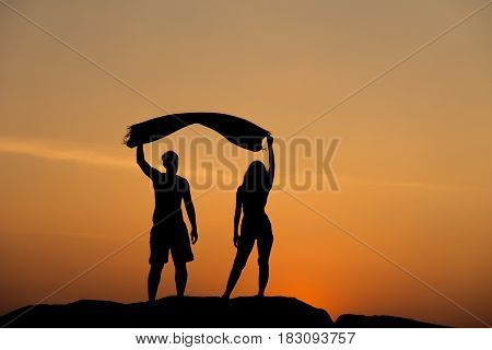 Silhouette Of Attractive Confident Half Naked Man And Woman Holding Hands