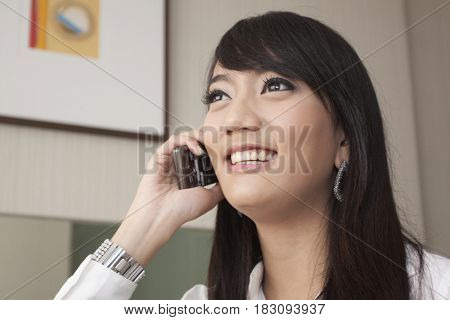 Asian woman talking on cell phone
