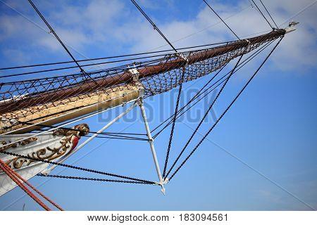 Masts and rope of sailing ship old boat detail