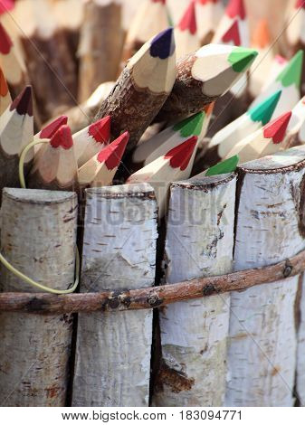 Set of color pencils outdoor background nature wooden