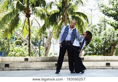 Couple dancing in courtyard