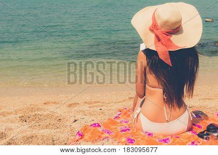 Beautiful Asian Bikini Woman Sitting On Beach Reading A Book Novel