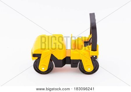Isolated Model Of Yellow Steamroller On White Background
