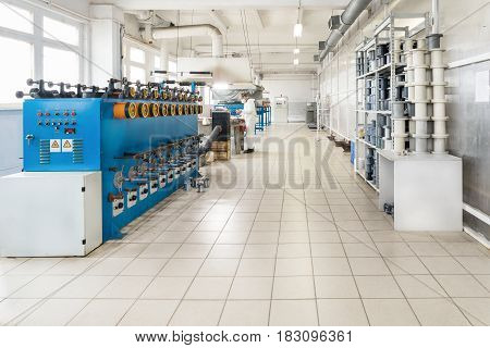 Shop for the production of wire. Automatic winding machine.