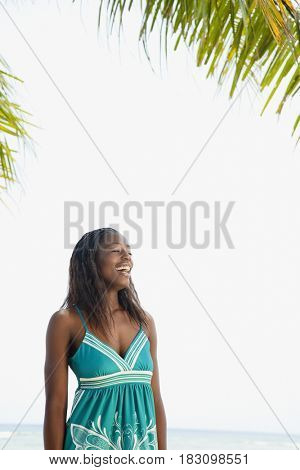 African woman laughing on beach