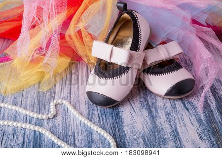 Baby Girl Pink Shoes Near Pearls And Colored Tulle.