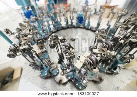 Modern braiding machine. Equipment for making braids from metal wire.