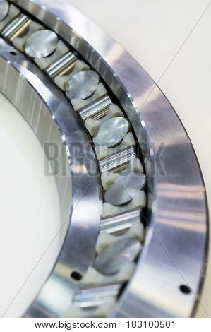 Fragment of a large roller bearing. Abstract industrial background.