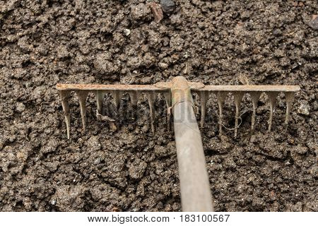 Loosening Of The Ground By A Rake