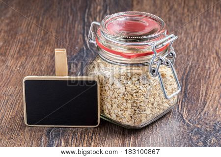 Oat flakes in a glass jar and blackboard