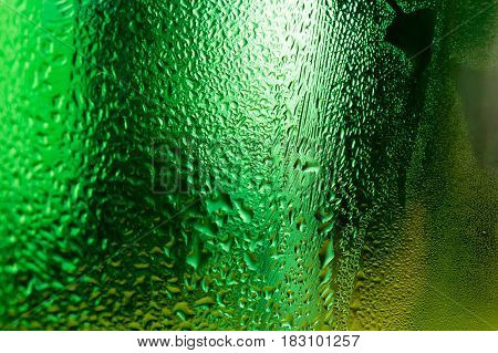 Water condensed on green glass surface abstract background.