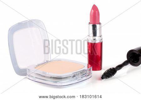 Make-up powder, lipstick and mascara isolated on white background.