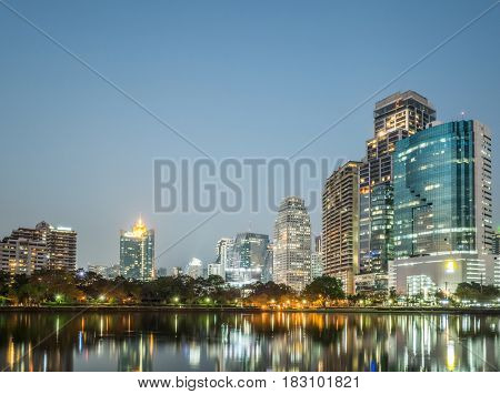 cityscape of night with skyscrapers and lake at bangkok, asia