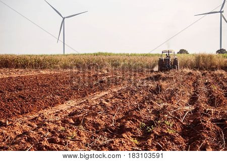 ground where the farmer is plowing soil for crops.