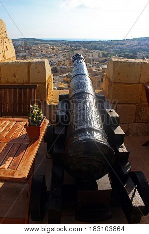 view from the citadel of Mdina Malta to the newer part of the town with cannon