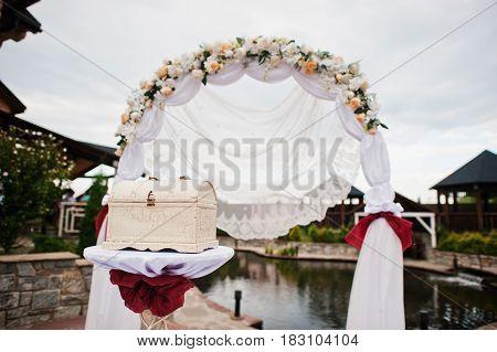Decor Wedding Arch At Ceremony Outdoor.