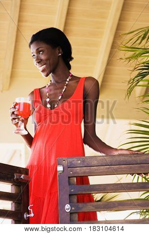 African woman holding cocktail