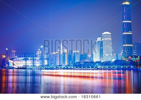 Zhujiang River and modern building of financial district at night in guangzhou china. poster