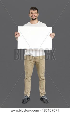 Adult Man Holding Blank Paper Board Studio Portrait