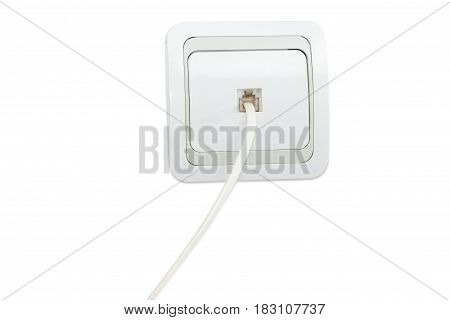 White and gray domestic telephone wall socket with the connected corresponding telephone cable on a light background