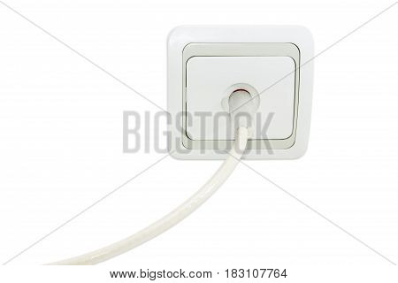 White and gray domestic TV aerial wall socket with the connected corresponding TV coaxial cable on a light background