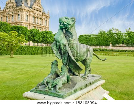 Bronze sculpture Tigress Carrying a Peacock to her Cubs. Sculptor Auguste Cain 19th century placed in the Tuileries Garden Paris.