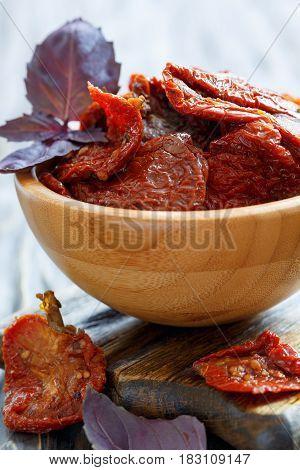 Sun-dried Tomatoes And Purple Basil Close-up.