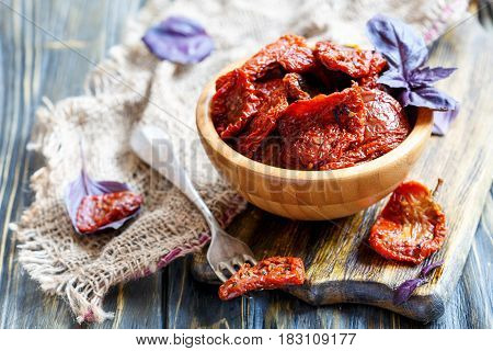 Sun-dried Tomatoes In Wooden Bowl And A Fork.