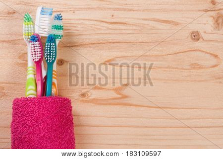 toothbrushes on the light wooden background with copy space for your text. Top view.