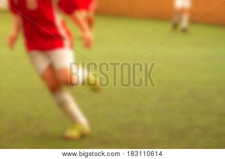 Blur kid soccer player on football pitch abstract sport background