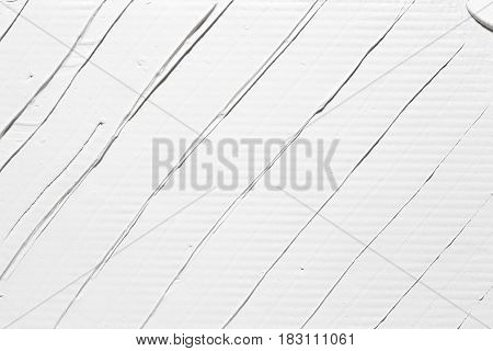 Abstract white background with relief diagonal stripes, plaster texture. Wall backdrop with free space for text.