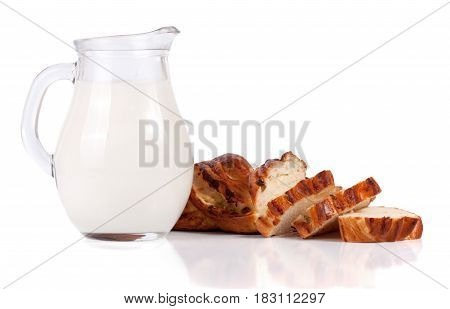 jug of milk with a loaf of bread isolated on white background.