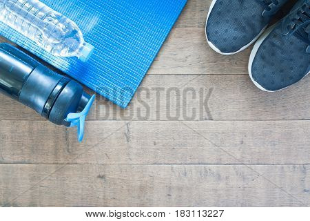 Sport and workout equipment on wood background Flat lay of healthy lifestyle concept