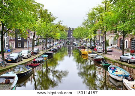 View of Amsterdam canal with boats