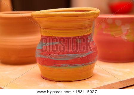 Cay pot painted, pottery craft, moulding the pot with your hands, sculpting hands